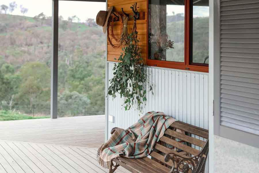 Kestrel-Nest-Eco-Hut-Verandah-and-Chair