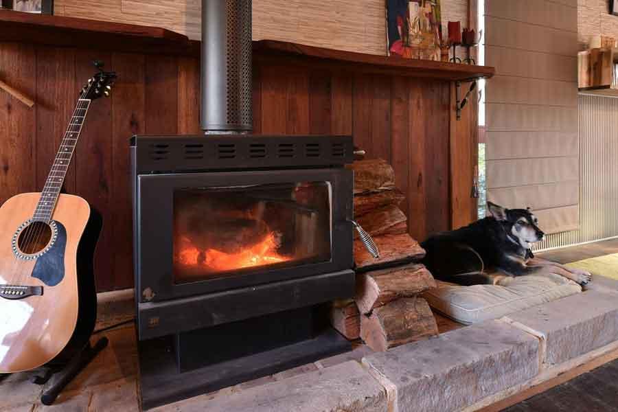 Millfield-Eco-Lodge-fireplace-pet